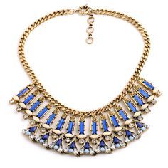 Make a statement with a chunky vintage gold necklace with colored crystal inspired pendant accents. #streetstyle