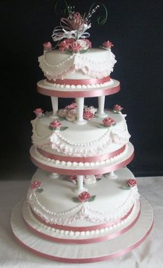 Traditional Wedding Cake supported on cake pillars with fondant sugar flowers and frilled side design can be made as either Sponge cakes or Rich Fruit cakes Cake Boss Wedding, Vegan Wedding Cake, Amazing Wedding Cakes, Wedding Cake Toppers, Amazing Cakes, Wedding Cake Fresh Flowers, Floral Wedding Cakes, Wedding Cake Rustic, Elegant Wedding Cakes