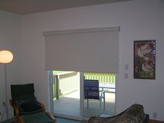 Merveilleux Big Roller Shade Over A Sliding Patio Door.