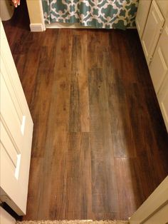 Upstairs bathroom remodel! The floor looks awesome ...and it's vinyl! $50 at Lowes and my dad easily installed in two hours :)