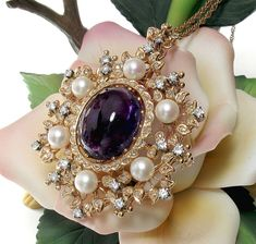 Beautiful Amethyst Cabochon & Diamond Brooch Pendant available from DIVINE FINDS JEWELRY at http://www.rubylane.com/item/490404-CABAmythystPinPend/Beautiful-Amethyst-Cabochon-Diamond-Brooch
