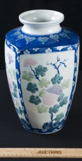 PAINTED CERAMIC VASE DONE IN A FLORAL DESIGN WITH BUTTERFLIES AND MULTI COLORED. STANDS AT 12IN. TALL.