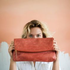 She's here! Limited run of the Lima Clutch in Scarlet. Only 38 available get it while it's hot!