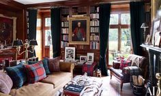 ✶Ralph Lauren's Refined Home in Colorado. Here, a circa-1774 portrait by Pompeo Girolamo Batoni is displayed between the library's French doors, which are curtained with a Ralph Lauren Home velvet; the two-arm Argand lamp is 19th century, and the pillows are made of antique fabrics✶