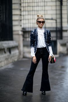 A white shirt with a black wide pants. This girl is so fabulous! Paris Fashion Week 2016.