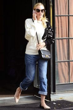 Rolled boyfriend jeans + cream & black baggy top + neutral pointed flats + black structured bag
