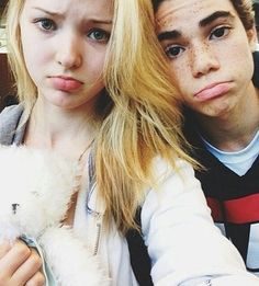 "Found-a-Rooney! The ""Jessie Goes Hawaiian"" episode promised the stars of ""Liv & Maddie"" and delivered the boys from the show. As a consolation prize, Cameron Boyce (Luke from ""Jessie"") poses for a selfie with Dove Cameron (Liv and/or Maddie)."