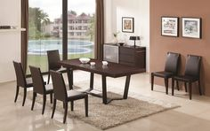 Modern dark oak wood finish rectangular shape dining table. Simple design and a great wood finish make this table a new attribute for your dining room decor. Dark oak table with extension (16 inch leaf). Sits up to 8 comfortably!