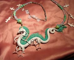"""Here the finished tribute to Ghiblis """"Spirited Away"""" Definately one of the most intricate. Spirited Away: Haku the Dragon - Necklace Spirited Away Dragon, Spirited Away Haku, Dragon Necklace, Dragon Jewelry, Biscuit, Chihiro Y Haku, Dragon Eye, Dragon Pendant, Polymer Clay Creations"""