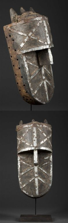 Africa | Mask from the Toma / Loma people of Guinea / Liberia | Wood, decorated with aluminium strips performed on the sides for attachment of a fiber costume | ca. prior to 1960