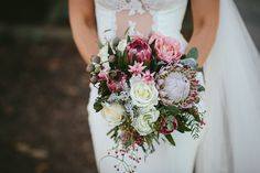 Native Bridal Bouquet with King protea, banksia, roses and gum nuts.