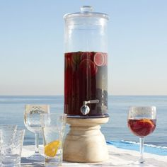 Sangria, anyone? Serve in style with this clear glass Drink Dispenser, set on a solid mango wood base.