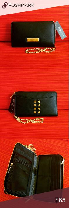 ??39?Olivia + Joy Black Zip Around Wallet ?NWT?  ?Made from high quality faux leather, this wallet features deep, luxuriously rich black color & gold tone hardware. Simply stunning! ?Polished Olivia + Joy plaque & stud embellishments at front ?Detachable gold chain wrist strap ?Zip around closure ?Interior Right?12 card slots, 1 zip pocket, 2 open compts Left?detachable coin zip pouch with 2 slip pockets, open phone compt, slip full length compts ??Abundant?functionality & pockets while…