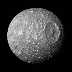"""Flying by the """"Death Star"""" Moon - March 29th 2010 - In this view captured by NASA's Cassini spacecraft on its closest-ever flyby of Saturn's moon Mimas, large Herschel Crater dominates Mimas, making the moon look like the Death Star in the movie """"Star Wars.""""  Herschel Crater is 130 kilometers, or 80 miles, wide and covers most of the right of this image. Scientists...   http://www.nasa.gov/cassini and  http://saturn.jpl.nasa.gov."""