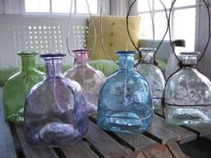 """Patron oil lights.  Use 3/4"""" fiberglass wick and 1 1/2"""" washer w/ 1/2"""" opening.  (Upcycling)"""