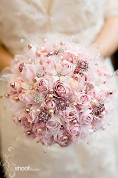 We carry a full line of bouquet accents for your wedding day. Shop our large collection of Swarovski crystal and pearl bouquet picks, brooches, ribbon and bouquet wraps. Pearl Bouquet, Beaded Bouquet, Fabric Bouquet, Pink Rose Bouquet, Wedding Brooch Bouquets, Hand Bouquet, Bride Bouquets, Pink Roses, Bling Bouquet