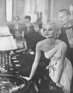 Avedon's 1954 picture of Harnett wearing a Grès gown at a casino was jet-set long before 007 ever spun a roulette wheel.   - HarpersBAZAAR.com