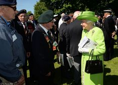 Greeting: The Queen raises a smile as she talks to a veteran while walking through the gro...