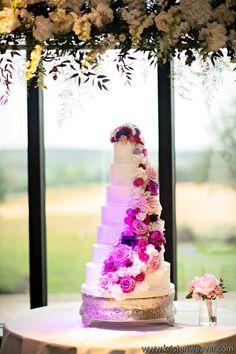 Nicole and Robert's seven-tier wedding cake looks amazing with the addition of fresh floral. We were proud to be a part of this beautiful Bella Collina wedding, planned by Blush by Brandee Gaar and photographed by Kristen Weaver Photography.
