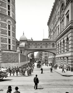 """""""New York City circa 1905. """"Bridge of Sighs."""" Named after a similar span in Venice, this covered passage connected the Tombs prison and Manhattan Criminal Courts building."""" (via Shorpy Historical Photo Archive)"""