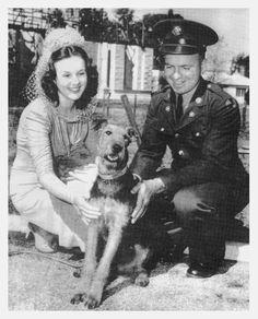 Common photo of actress Deanna Durbin, reproduced over the years:  On the 6th of March, 1941, Deanna Durbin presented Private Everett Scott, of Fort Ord, a 6 month old Airedale dog called Mickey, as a replacement for his previous pet Laddie who had died of a broken heart.