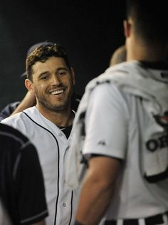 Tigers' Ian Kinsler smiles after he scores in the first