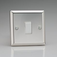 Mirror Chrome Light Switch with White inserts 1 or 2 way switching Rated at 10amp Suitable for switching either mains or low voltage lighting Bevelled Edge faceplate Dimensions 91x91x25mm BS EN 60669-1 – BRITISH MADE