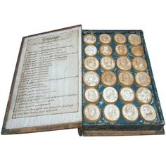 An Italian Grand Tour Cased Volume Of Plaster Intaglios - published as a Souvenir