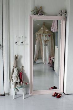 large mirror painted for her to see herself in dress up clothes, etc.