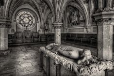 The tomb of Duke Frederick II and a beautiful stained glass window at Heiligenkreuz Abbey, Austria