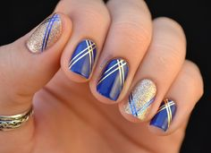 Royal blue nails with gold glitter and stripes. This is one glitzy manicure! Get the polish from Walgreens.com.