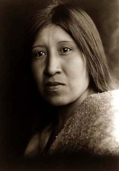 You are viewing an captivating image of a Desert Cahuilla Indian Woman. It was taken in 1924 by Edward S. Curtis. The picture shows a Head-and-shoulders portrait of this Beautiful Native American woman, facing left This Woman of the Desert has striking eyes, and is not smiking, but appears happy. We have created this collection of pictures primarily to serve as an easy to access educational tool. Contact curator@old-picture.com. Image ID# 0078A3B4