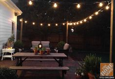 Strings of lights create the perfect glow for an outdoor room. Bryn installed wooden posts at the corner of her brick patio so that she could create a lighted canopy! #heartoudoors