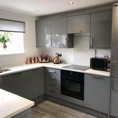 100 Beautiful Kitchens Competition #greykitchendesigns For our 100 Beautiful Kitchens competition, we asked builders to share photos of a Howdens kitchen they have installed. This is our Clerkenwell Gloss Grey kitchen, shared by @robinupton1 on Instagram. For more inspiration, visit Howdens.