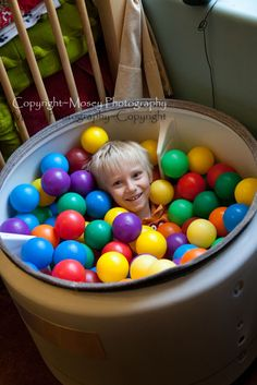 Creating a Sensory Processing Disorder friendly bedroom - this is an old dryer drum filled with balls.  Chris saw this picture and immediately asked to get in too.