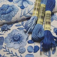 Blue and White Embroidered Floral Design