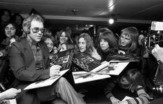 Elton John signs copies of his new album, Don't Shoot Me I'm Only The Piano Player at the Noel Edmonds Record Shop, Chelsea, 1973.
