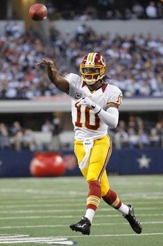 Week 12 - Redskins QB Robert Griffin III throws a pass on the run in the second half.