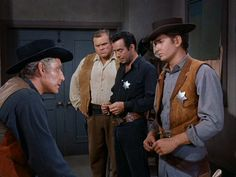 Joe arguing with the Sheriff about saving his Pa, while Hoss and Adam try to come up with a rescue plan for Ben. - Death at Dawn.