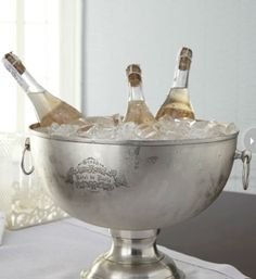 Beverage tub  If there's one beverage that will be flowing on New Year's Eve, it will definitely be champagne or sparkling wine. Don't worry about keeping your bubbly extra chilled, because this big pewter and brass tub will hold at least a few bottles and ice. Horchow, $315.