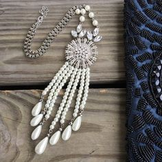 Pearl and Rhinestone Wow Necklace Never worn. NWOT. Beautiful dangling pendant and drop pearl design. Measurements forthcoming.  NO TRADES/NO PAYPAL. Reasonable offers accepted via the offer button below. Jewelry Necklaces