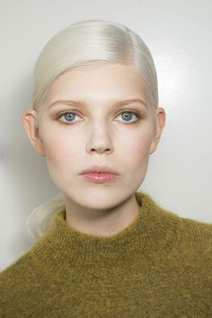 Makeup artist Diane Kendal employed an interesting trick for creating the soft, hazy eye look: She first applied brown cream shadow, then used a q-tip dipped in a face serum to sheer the color out into a watercolor effect. ... and slicked back w mousse