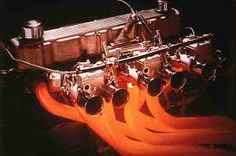 Heart of the Valiant R/T Charger: Hemi 265 with triple DOHC 45mm webbers, image from original 70's advertising shows factory extractors running read hot.
