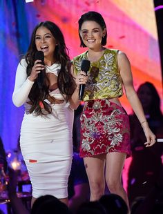 Janel Parrish and Lucy Hale speak onstage during the Teen Choice Awards 2017 at Galen Center on August 13, 2017 in Los Angeles, California.