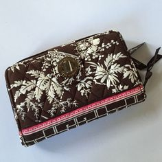 """NWT Vera Bradley wallet This is a new Vera Bradley """"turn locket wallet"""". The colors are brown, off-white, and pink. The width is approximately 7.5"""" and height is approximately 5"""". Vera Bradley Bags Wallets"""