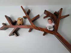 TREE BRANCH BOOKSHELF etsy So cute! And a cute baby too!! :) lol