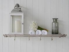Chrome Bathroom Shelf With Hooks For Hanging Towels. Bathroom Furniture