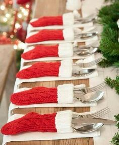 Knitted red Christmas stockings silverware dining table