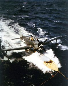 One of heavy cruiser USS Alaska's Curtiss floatplanes waited for pickup by the ship's crane, off Iwo Jima, 6 Mar 1945 Alaska, Heavy Cruiser, Iwo Jima, National Archives, Us Navy, World War Ii, Crane, Wwii, History
