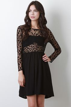Are your on the prowl for that perfect wild trend? Your hunt is over with this Lacy Leo Dress! This dress features semi-sheer leopard spot lace top with a round neckline, long sleeves, elasticized waist, contrasting skirt with underlining